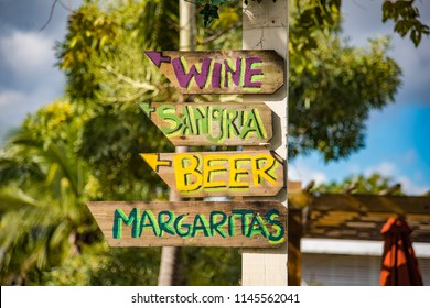 Directional Island Caribbean Beach Happy Hour Signs Pointing to Wine, Sangria, Beers, Mimosas and Margaritas.