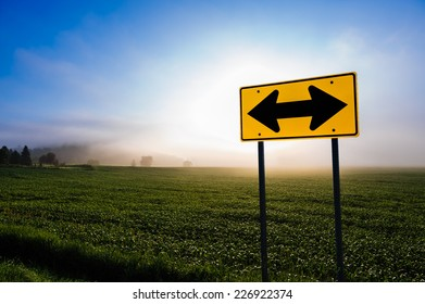Directional road sign in front of a corn field, Stowe, Vermont, USA.