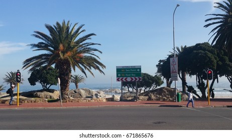 Directional road sign with traffic lights, Camps Bay near Cape Town, Western Cape, South Africa