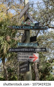 directional sign in Bluffton SC with arrows for May River, Charleston, Palmetto Bluff, Daufuskie, TYB, and the Bluffton Oyster Comapny