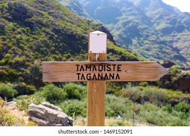 Directional sign to coastal village of Taganana and Tamadiste beach, Tenerife, Canary Islands, Spain. Natural trekking tourism concept.