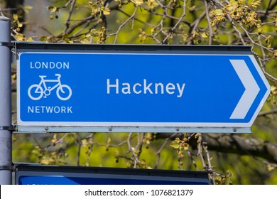 A directional sign for cyclists pointing towards the Hackney area of London in the UK.