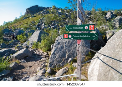 """directional sign to the famous preikestolen. Preikestolen or Prekestolen (English: """"The Pulpit Rock"""" or """"Preacher's Chair"""") is a tourist attraction in the municipality of Forsand in Rogaland county"""