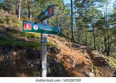"""directional sign to the famous preikestolen. Preikestolen or Prekestolen (English: """"The Pulpit Rock"""" or """"Preacher's Chair"""") is a tourist attraction in the municipality of Forsand in Rogaland county,"""