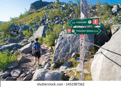 """directional sign to the famous preikestolen. Preikestolen or Prekestolen (English: """"The Pulpit Rock"""", """"Pulpit"""" or """"Preacher's Chair"""") is a tourist attraction in the municipality of Forsand in Rogaland"""