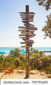 Directional signpost on the southernmost point of USA- Key West, Fort Zachary Taylor Historic State Park tropical sandy beach on daylight