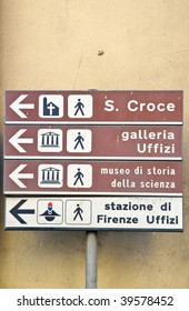 Directional signs to landmarks on street in Florence, Italy