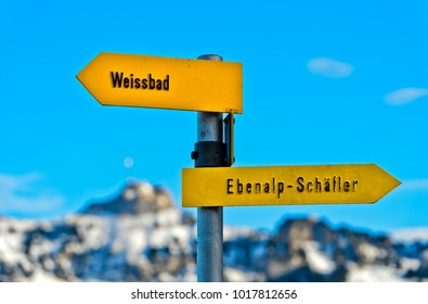 Directional signs pointing in opposite directions towards Weissbad and Ebenalp-Schäfler, peak Hoher Kasten behind, Schwende, Canton Appenzell Ausserrhoden, Switzerland