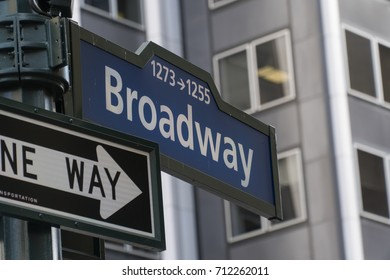 Directional street sign down famous Broadway in Manhattan New York City through times square towards downtown