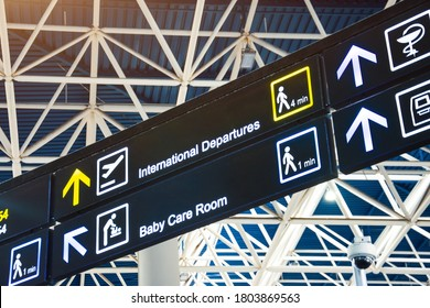 Directions on the sign at the airport - International Departures and baby care room.