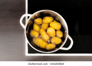 directly above shot of cooking pot with potatos and water on stove