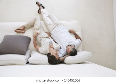 Directly above shot loving couple relaxing on sofa