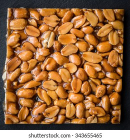 Directly above shot of Peanut brittle on black background