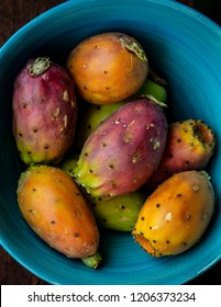Directly above shot of prickly pear fruit in a blue bowl