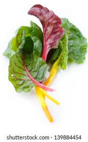 Directly above shot of Rainbow Swiss chard leaves on white background