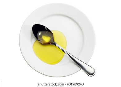 Directly above shot of spoon and olive oil on plate on white background