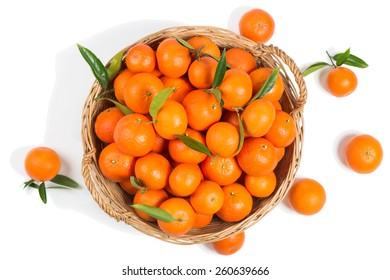Directly above shot of tangerines in big  wicker basket isolated over white background