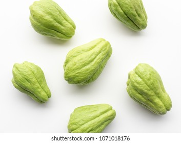 Directly above view of chayote or choko arranged on a white table