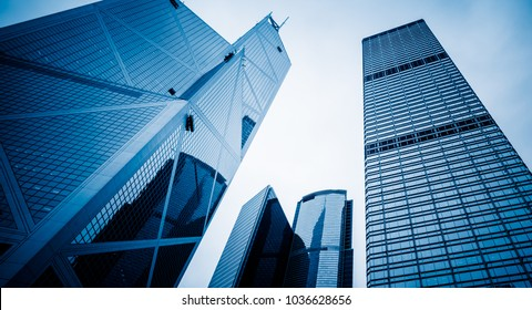 directly below of modern office block buildings in Hong Kong,blue toned,China.