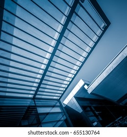 Directly Below Shot Of glass Skylight in a modern building.