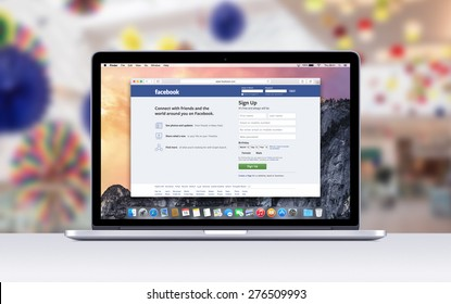Directly front view of Apple MacBook Pro 15 Retina with an open tab in Safari which shows Facebook registration page. Blurred shopping center on the background. Varna, Bulgaria - November 03, 2013.