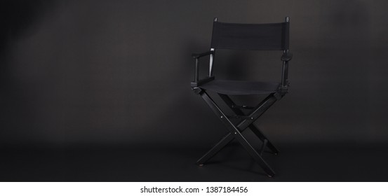 Director chair use in video production , film, cinema industry on black background
