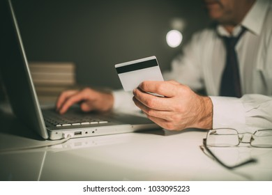 The director checks the credit card
