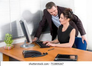 A director of company with his attractive secretary