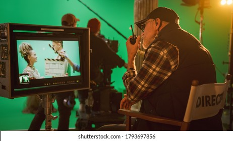 Director Gives Commands Shooting History Movie Green Screen CGI Scene with Actors Wearing Renaissance Costumes. Big Film Studio Professional Crew Shooting Big Budget Movie. Back View Shot