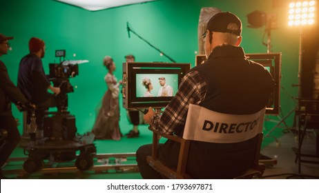 Director Shooting Period Film Green Screen CGI Scene with Actors Wearing Renaissance Costumes. Big Film Studio Professional Crew Shooting Big Budget Movie. Back View Shot