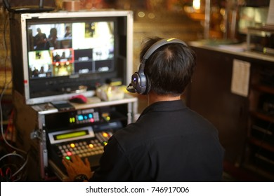 Director working on the video or media switcher to edit and broadcast video.