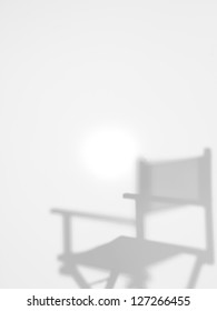 director's chair behind a diffuse surface, back lit