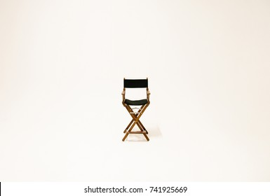 Directors chair isolated on a white background. Space for text. Vacant chair. The concept of selection and casting.