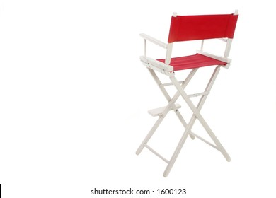 Director's chair with red seat and back on a white frame. Isolated on white background.  Copyspace room on left for text.