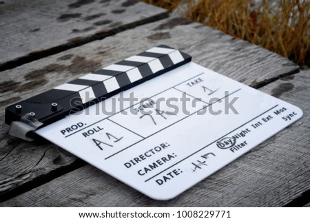 directors clapboard on wooden walkway on stock photo edit now