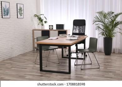 Director's office with large wooden table. Interior design