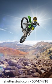 Dirt bike rider flying high on the top of vulcan