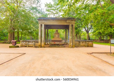 Dirt footpath leading to sacred Samadhi Buddha Statue in ancient capitol of Anuradhapura in Sri Lanka. Horizontal