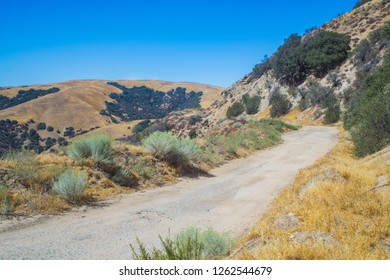 Dirt and gravel road leading through the mountain wilderness of southern California outside Los Angeles.