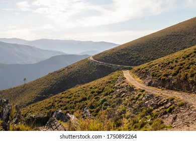 dirt path between the mountains, with green bushes around it, Arouca, Portugal