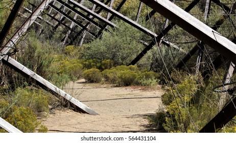 Dirt Path Through Metal Jetty Jacks