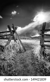 Dirt pathway leading through a gate in Grand Teton National Park, WY.
