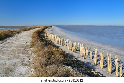 dirt road in an abandoned salt evaporation pond, in Camargue natural park, France