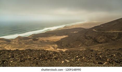 Dirt road along ridge of hills along coast of Cofete, Fuerteventura, Canary Islands, Spain.
