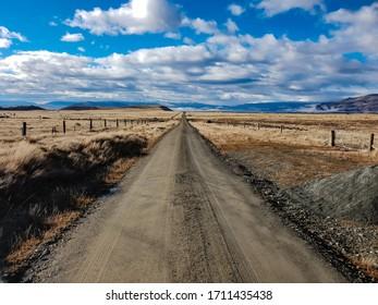 Dirt road extending into the horizon.