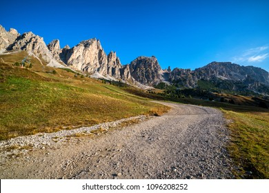 Dirt road and hiking trail track in Dolomites mountain, Italy, in front of Pizes de Cir Ridge mountain ranges in Bolzano, South Tyrol, Northwestern Dolomites, Italy.