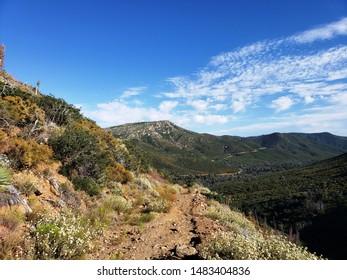 Dirt road leading along a mountain side, California