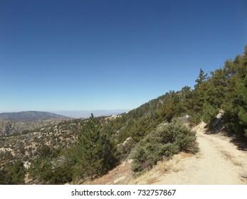 Dirt road leading down a mountain, California