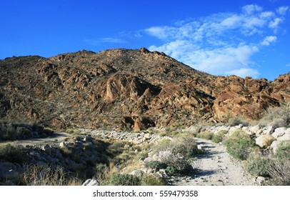 Dirt road leading toward mountains in the desert, Palm Springs, CA