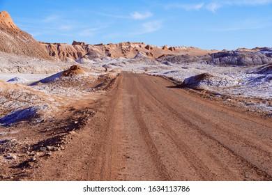 Dirt road in the Moon valley in Atacama desert near San Pedro de Atacama, Chile.